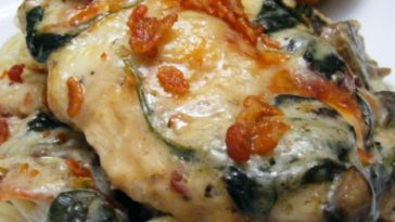 Chicken Florentine Casserole Recipe - which can also be adapted with either fish or shrimp, lies on a bed of spinach leaves and mushrooms #chicken #chickenrecipe #chickenrecipes #chickenflorentine #chickenflorentinecasserole #chickencasserole #chickencasserolerecipe #casserole #casserolerecipes